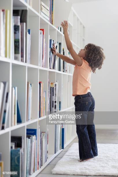 Girl Reaching for Book
