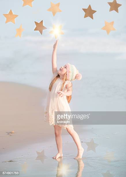 Girl reaching for the stars