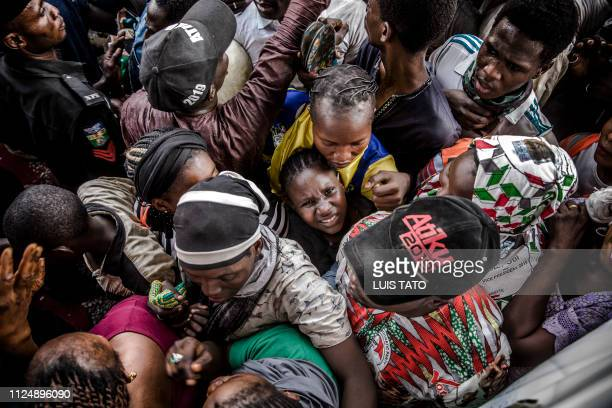 A girl reacts as she stand in the crowd during the final campaign rally of the Nigerian opposition Peoples Democratic Party presidential candidate on...