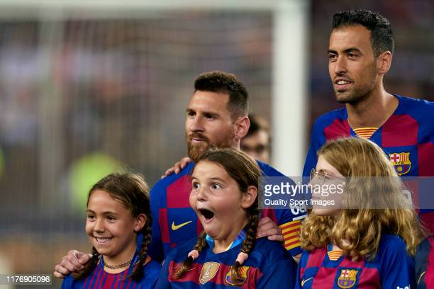 Girl reacts when Lionel Messi of FC Barcelona poses for a photo prior to the Liga match between FC Barcelona and Villarreal CF at Camp Nou on...