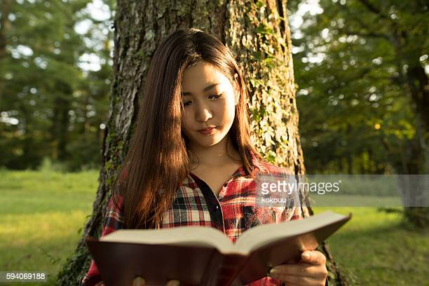 Girl reading a book at afternoon.