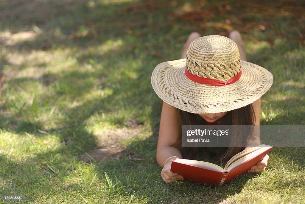 Girl reading a book : Stock Photo