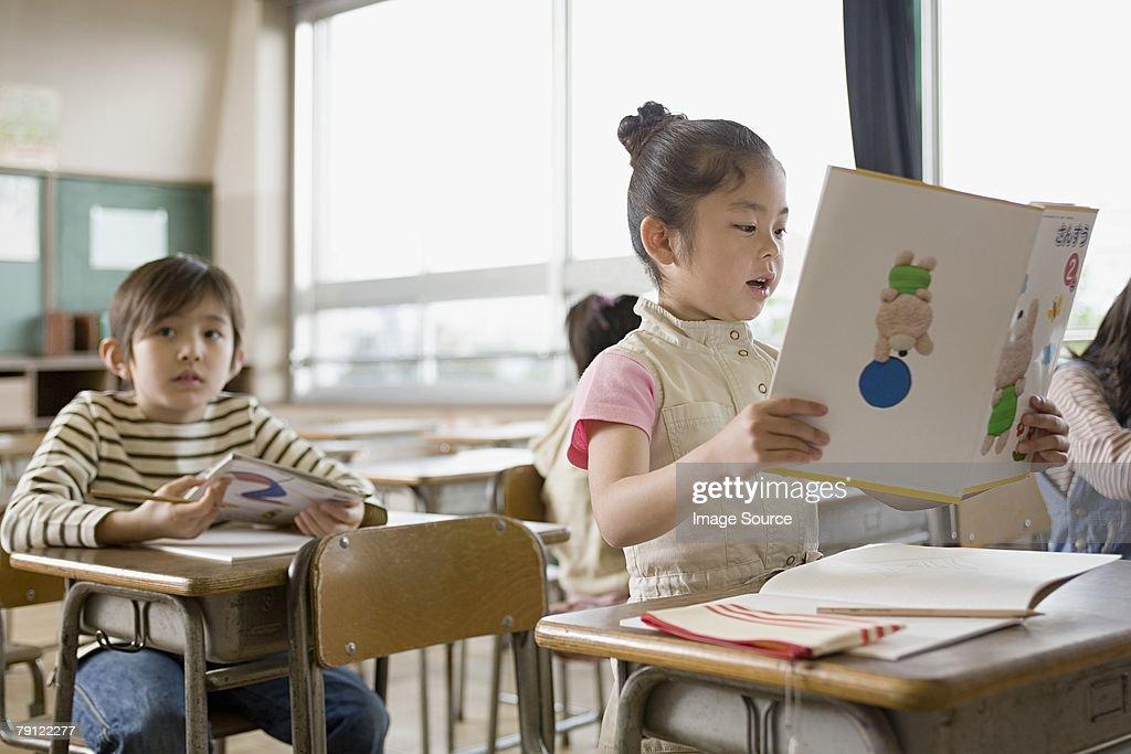 A girl reading a book : Stock Photo