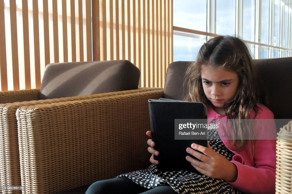 Girl reading an electronic boo : Stock Photo