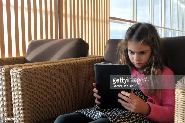 Girl reading an electronic boo