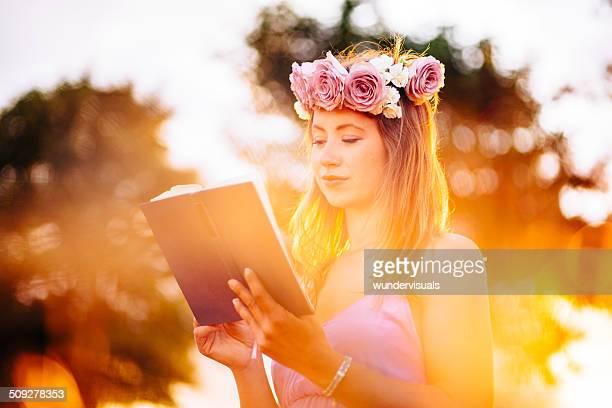 Girl Reading At Sunset