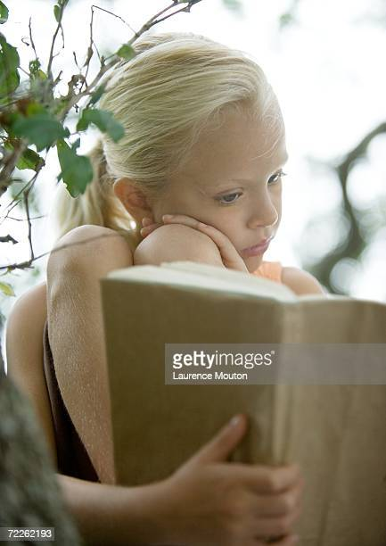 girl reading book - girls open legs stock photos and pictures