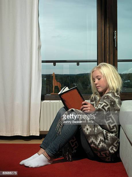 girl reading book - girls in socks stock photos and pictures