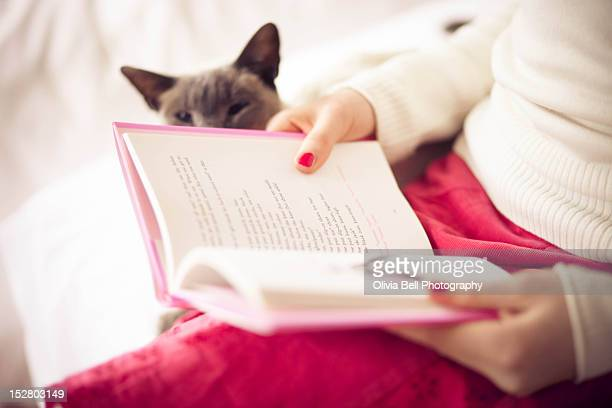 Girl reading book with Cat