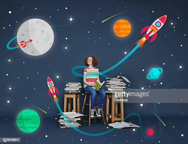 girl reading books. cartoon space scene - vorstellungskraft stock-fotos und bilder