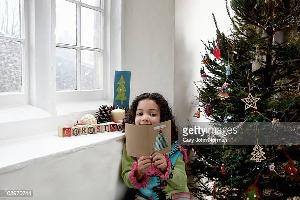Girl reading christmas card