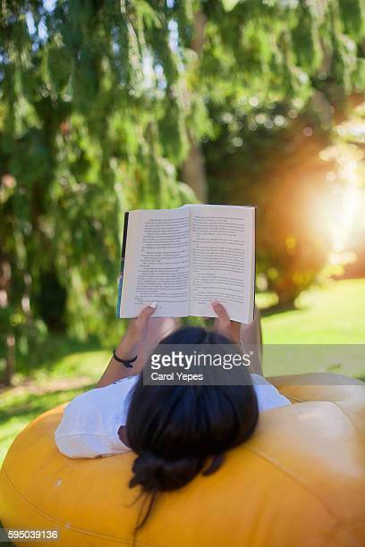 girl reading in the nature - literature photos et images de collection
