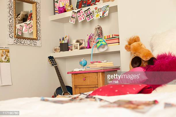girl reading magazine on bed