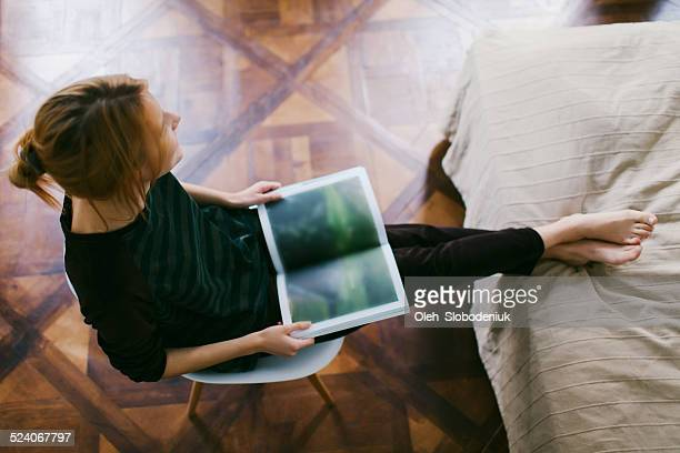 girl reading magazine - magazine stock pictures, royalty-free photos & images