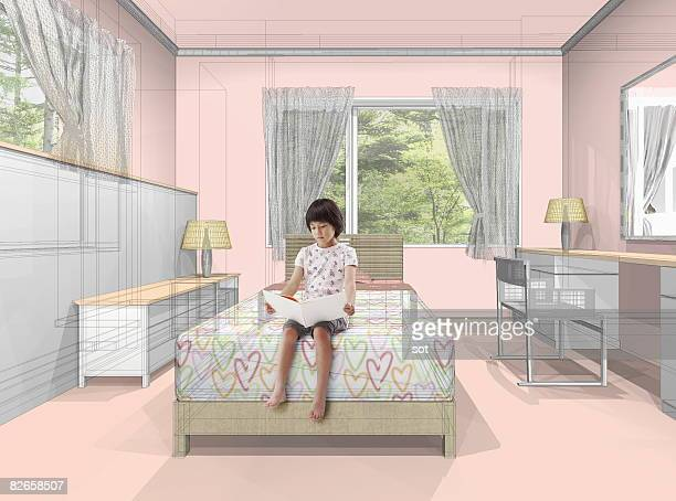 Girl reading on bed in