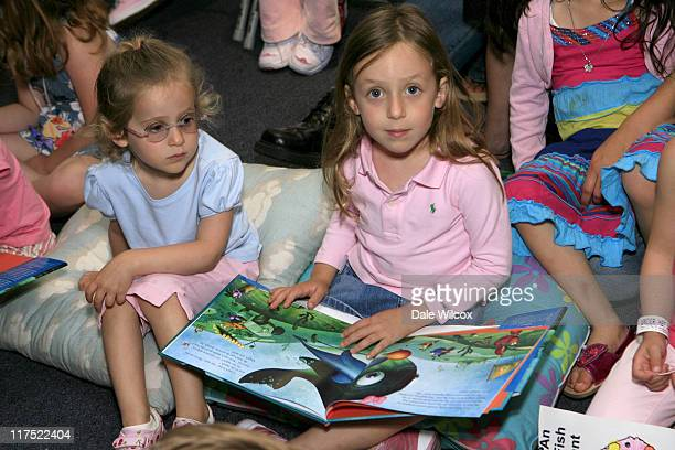Girl reading Peter Farrelly's new children's book Abigale the Happy Whale