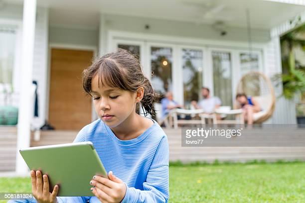 Girl reading something on a digital tablet