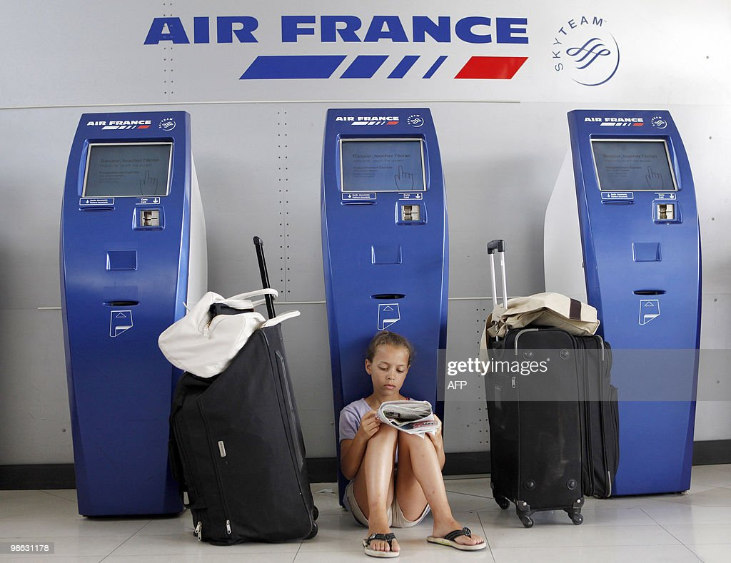 A girl reads as she waits for a flight with her family at the Fort-de-France Aime Cesaire airport in Le Lamentin, on April 19, 2010 on the French island of Martinique. Air traffic remained seriously disrupted across Europe as a cloud of ash released from Iceland's volcanic eruption forced many countries to close their airspace. Most French airports including international hubs Charles de Gaulle and Orly will stay closed until on April 20.
