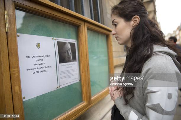 A girl reads the obituary at Gonville and Caius College in Cambridge United Kingdom to pay tribute to world renowned physicist Stephen Hawking who...
