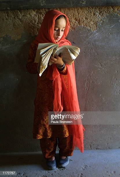 A girl reads to the class as they study the Persian language at the Noor school for Afghan refugees October 31 2001 in Quetta Pakistan There are 450...