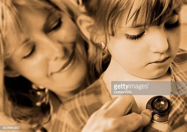 Girl Receiving a Chest Examination