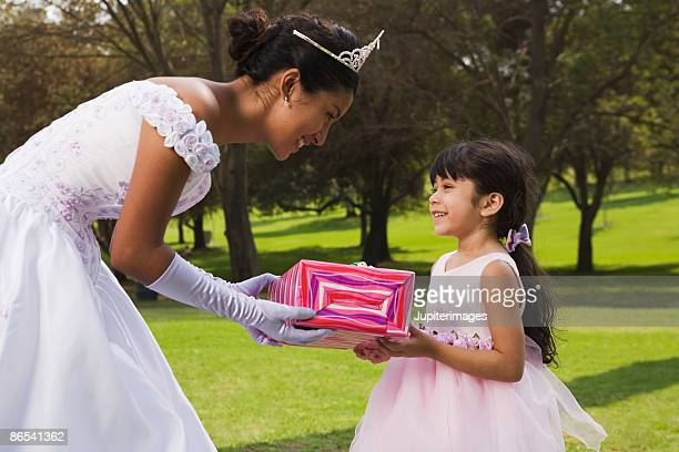 girl receiving gift - quinceanera stock pictures, royalty-free photos & images