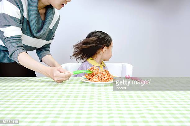 Girl refusing to eat spaghetti