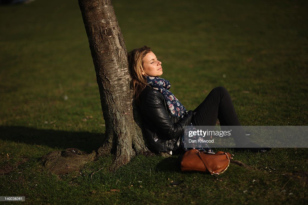 A girl relaxes in St James's Park on March 1, 2012 in London, England. After a recent cold snap Britain is expected to see a short period of unseasonably mild weather following one of the driest February's on record according to the Met Office.