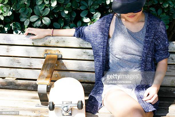 girl relaxing at a bench - yusuke nishizawa stock pictures, royalty-free photos & images