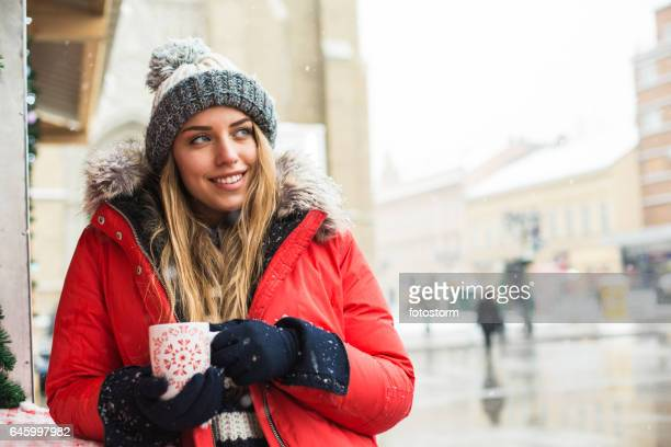 Girl relaxing at outdoors winter cafe