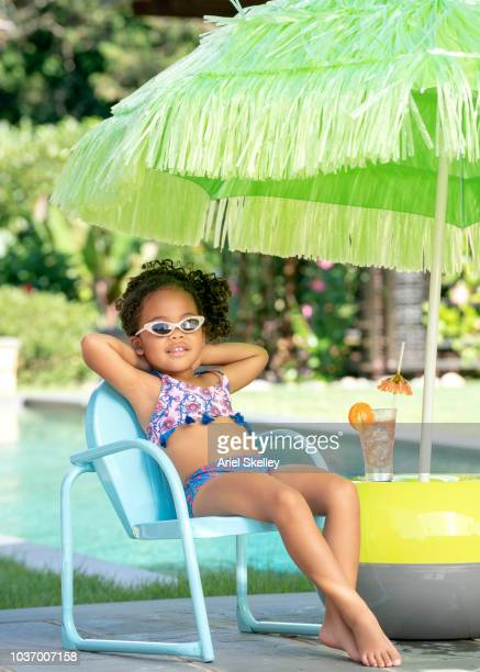 Girl Relaxing by Swimming Pool