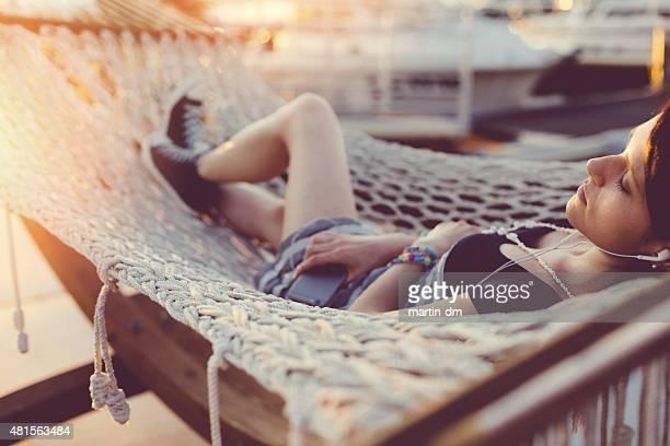 Girl relaxing in hammock