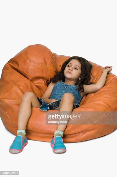 girl relaxing on a bean bag - bottomless girls stock photos and pictures