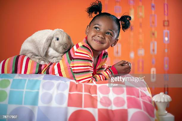 girl relaxing with pet rabbit - african american easter stock photos and pictures