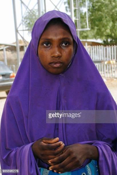 A girl released by Boko Haram walks outside Dapchi's hospital on March 21 2018 Boko Haram Islamists who kidnapped 110 schoolgirls in Dapchi northeast...