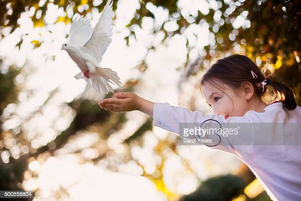 girl releasing a dove