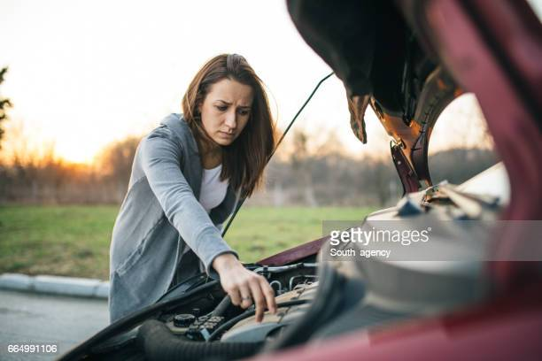 Girl repairing the car