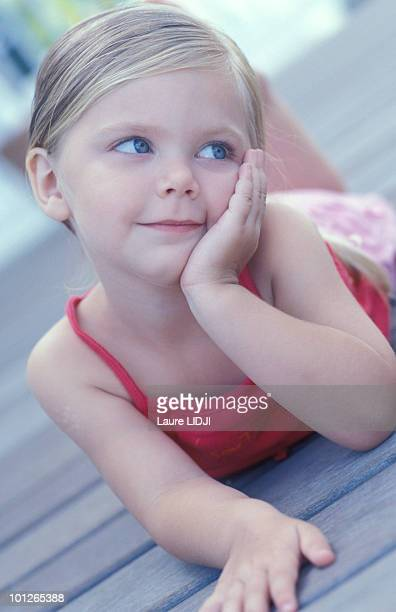 Girl resting head on hand