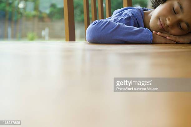 Girl resting head on table