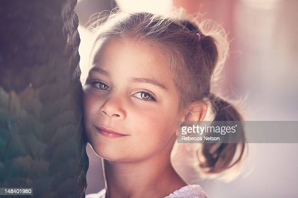 girl resting her head against pillar - rebecca nelson stock pictures, royalty-free photos & images