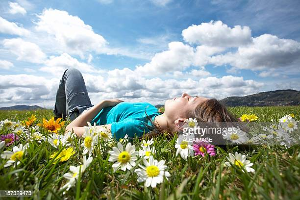 Girl resting in meadow 2