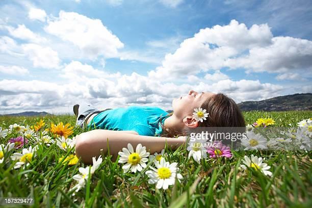 Girl resting in meadow 5