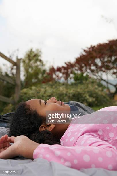 Girl resting on tent