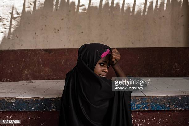 A girl rests on an unused counter inside a produce market on October 11 2016 in Barawe Somalia Barawe was a stronghold for the AlShabaab militant...
