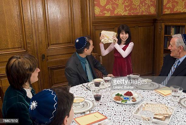 girl returning the afikomen - passover seder plate stock pictures, royalty-free photos & images