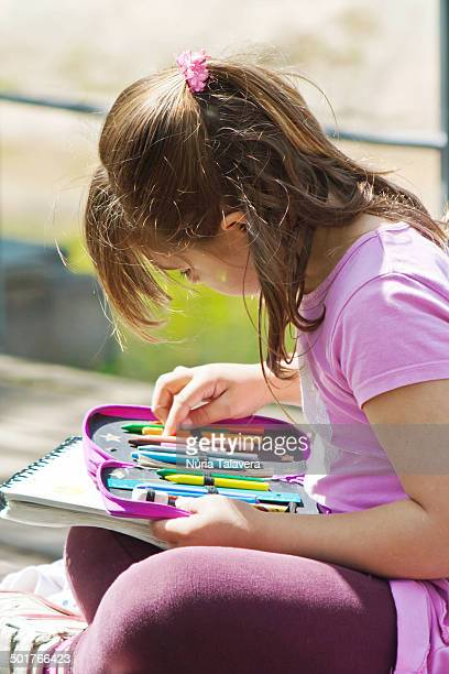girl reviewing its pencil case - pencil case stock photos and pictures