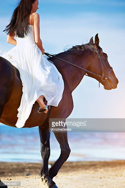 girl rides along the beach on a horse - girl blowing horse stock pictures, royalty-free photos & images
