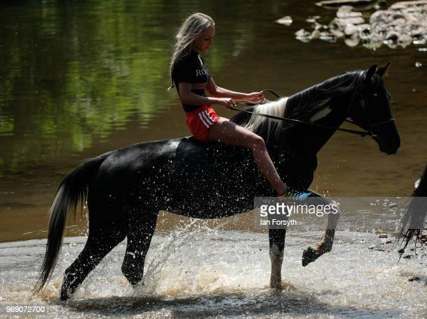 A girl rides her horse out of the River Eden on the first day of the Appleby Horse Fair on June 7 2018 in Appleby EnglandThe fair is an annual...