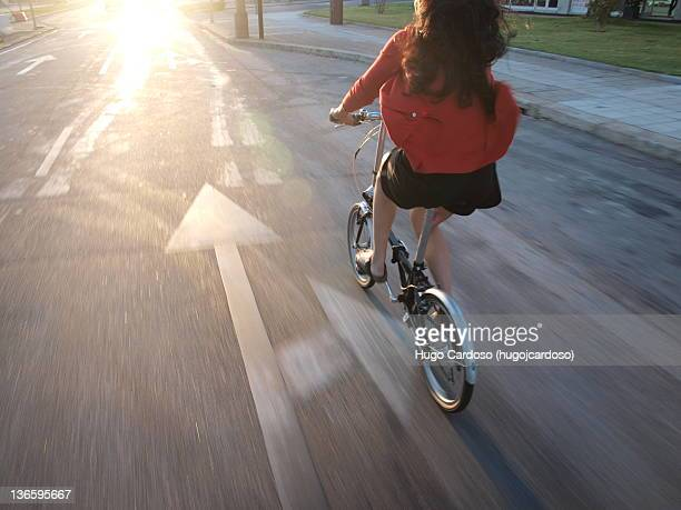 Girl riding a bicycle with wind in her hair
