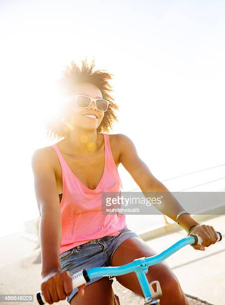 Girl riding a bike on the street